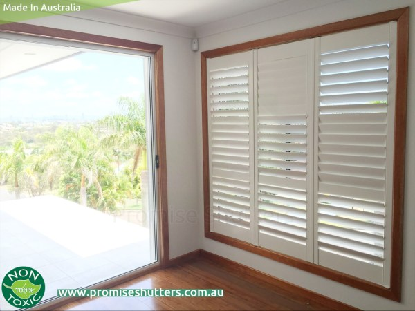 White Solid Vinyl Plantation Shutters With Wood Architrave