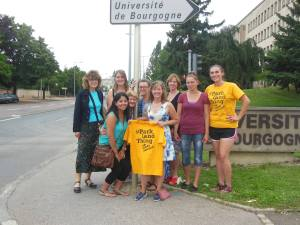 Photo courtesy of Jody Littleton/Parkland College (From Left) Rebecca Grosser, Nadya Cortes, Grace Dyrek, Susan Foster, Joanna Piwoni, Jody Littleton ,Nancy Lane, Candice Milk, Julia Drewitz stand in front of the University de Bourgogne in Dijon, France.