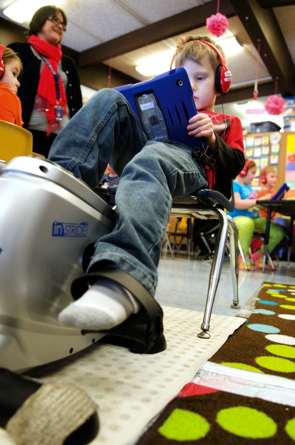 Photo by Alex T. Paschal | AP Photo/Sauk Valley Media In this Feb. 10, 2015 photo, Davin, a kindergartener in Andrea Brenner's class at Jefferson Elementary School in Sterling, Ill., pedals on a stationary machine while working on his math homework. The school has implemented the use of the machines that help some children expel their extra energy and focus on their school work.
