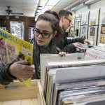 Belleville News-Democrat, Derik Holtmann | AP Photo  In this March 4, 2015 photo, vinyl album enthusiasts Brittany Dove, left, and Tyler Lambert browse through the albums at Rich's Record Emporium in downtown Collinsville, Ill. The store features new and used vinyl records, hi-fi equipment and more.