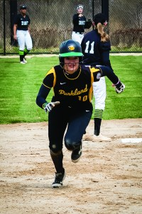 Photo by Scott Wells | The Prospectus  Freshman outfielder Megan Magsamen makes her way to third base during the first game against Danville on Mar. 20, 2016.  The Cobra's split on the day, winning the first game and dropping the second.