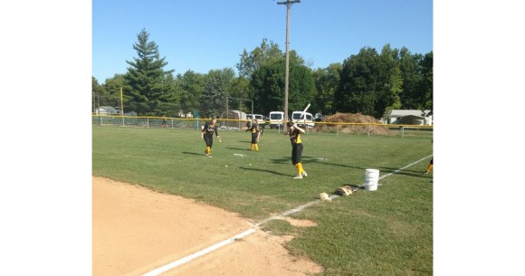 Photo provided by Softball Coach Chuck Clutts | Softball players warm up before a game.
