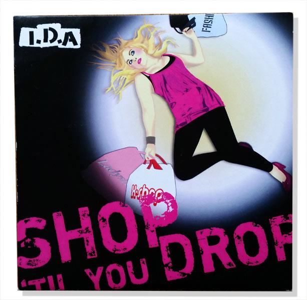 """Illustrerat skivkonvolut till artisten I.D.A. och låten """"Shop until you drop"""""""