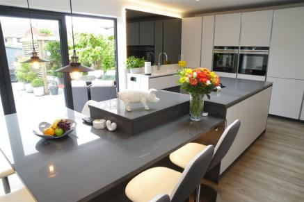 Grey tinted mirror and Y ukon/Marengo worktops with Siemens appliances