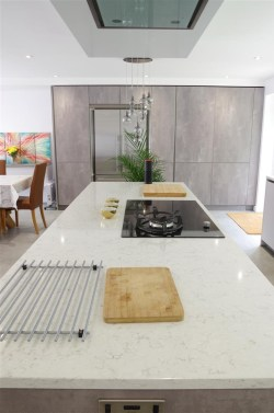 Putty Concrete Pearl Grey Kitchen with AEG Appliances and ActiveSmart Fridge