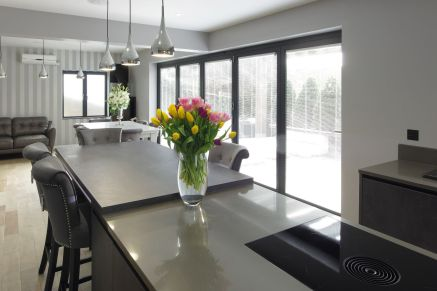 BORA Pure Induction cooktop on kitchen Island (silestone - cemento spa/ polished) with connected breakfast bar