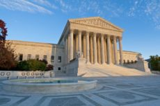 10575949 - the front of the us supreme court in washington, dc, at dusk.