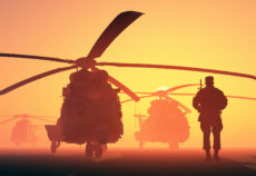 28583904 - a group of military helicopters and the silhouette of a soldier.
