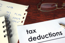 59156309 - tax deductions written on a paper. financial concept.