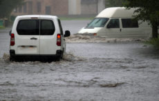 41917739 - car rides in heavy rain on a flooded road