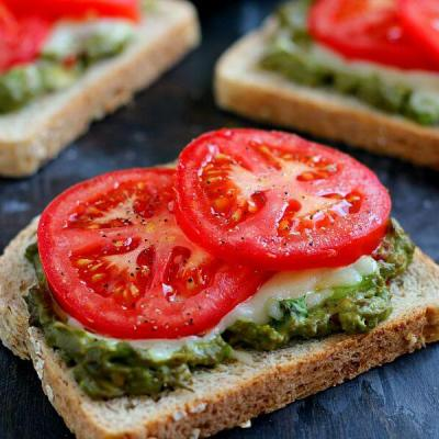 This Cheesy Guacamole Toast is loaded with creamy guacamole, mozzarella cheese, and fresh tomatoes. Full of flavor and healthy ingredients, this toast makes the perfect breakfast or mid-morning snack!