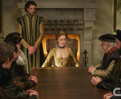 "Queen Elizabeth I sitting with her noblemen in Reign's ""Strange Bedfellows"""
