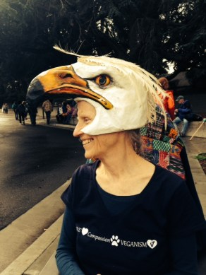 """Jean Stewart, marching with """"Animals Against Extinction,"""" in the Oakland Climate March. Feb. 2015"""