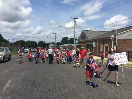 Kelly Donio of Toy Market leads the Bike Contest out to the Bellvue Avenue parade route.