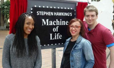BUXTON, UNITED KINGDOM - Zainab, Amanda and Sam stand next to Stephen Hawking's Machine of Life. This machine shows the chain reactions inside the human body.