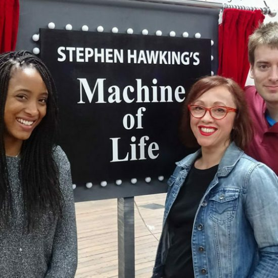 BUXTON, UNITED KINGDOM - Zainab, Amanda and Sam stand next to Stephen Hawking's Machine of Life. This machine shows the chain reactions inside the human body.(photo credit:  Bigger Bang Communications/Grant Covacic)