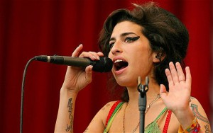 -...(FILES) In this June 22, 2007 file picture, British pop singer Amy Winehouse performs at the Glastonbury music festival, in Pilton, Somerset, in south-west England.Troubled British singer Amy Winehouse has been found dead at her flat in north London, media reports said on July 23, 2011. She was 27 years old. The soul singer fought long battles against drink and drug addiction.   AFP PHOTO / CARL DE SOUZA (Photo credit should read CARL DE SOUZA/AFP/Getty Images)