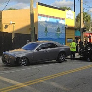 Rick Ross Rolls Rick Ross Target of Drive By Shooting and Crashes Rolls Royce