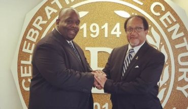 Shown in photo: Jonathan A. Mason, Sr. (left) and Dr. Benjamin Chavis (right). Mason shakes Dr. Chavis hands after presenting him with the keys for Phi Beta Sigma Fraternity, Inc. Headquarters, which will serve as the National Mobilization Headquarters for the 20th Anniversary of the Million Man March. (PRNewsFoto/Phi Beta Sigma Fraternity, Inc.)
