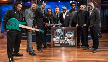 "LATE NIGHT WITH JIMMY FALLON -- Episode 819 -- Pictured: (center) Jimmy Fallon presents the Roots (l-r) Mark Kelley, Damon ""Tuba Gooding Jr."" Bryson, F. Knuckles, Captain Kirk Douglas, Black Thought, Questlove, Kamal Gray, James Poyser with a plaque commemorating their first RIAA-certified platinum album for their 1999 release, ""Things Fall Apart"" on April 22, 2013 -- (Photo by: Lloyd Bishop/NBC/NBCU Photo Bank via Getty Images)"