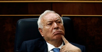 Spain's FM Garcia-Margallo reacts before Spanish lawmakers approved a non-biding motion at the Spanish Parliament in Madrid