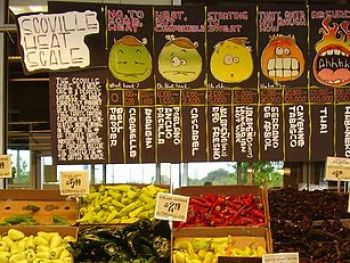 English: A display of hot peppers and a board ...