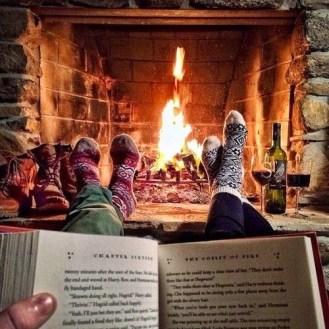 winter reading socks book fireplace fire