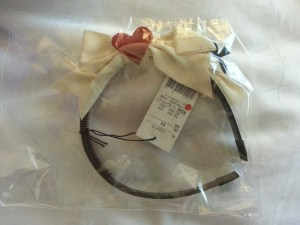 "This headbow is ""NWT"". Note the dot sticker. It indicates that I bought it on sale."