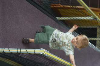NinjaBaby playing on the slide complex at Kids Central