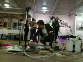 """Huey Walker & his Installation for three Guitars & Pearls & Peas & Bells as set up at the Vernissage of """"Toba"""" by Cindy Schmid (Photo: Shellack Holmes)"""