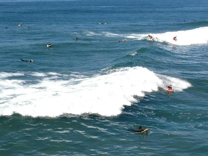 Pictures I took of surfers just hours before I tried my hand in the same area. Body boarding was my chosen activity.