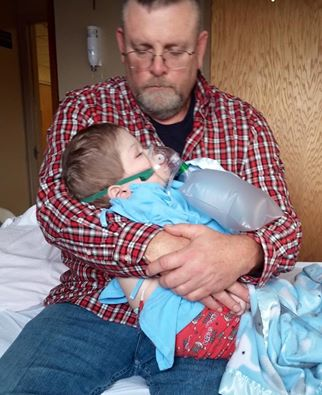 Reed being held by his daddy