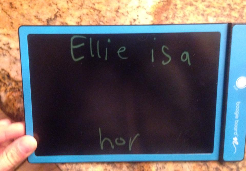 """Joel was writing """"Ellie is a horse"""" and got distracted. Ellie came running up to me with this and tearfully said, """"Joel called me a horse!"""""""