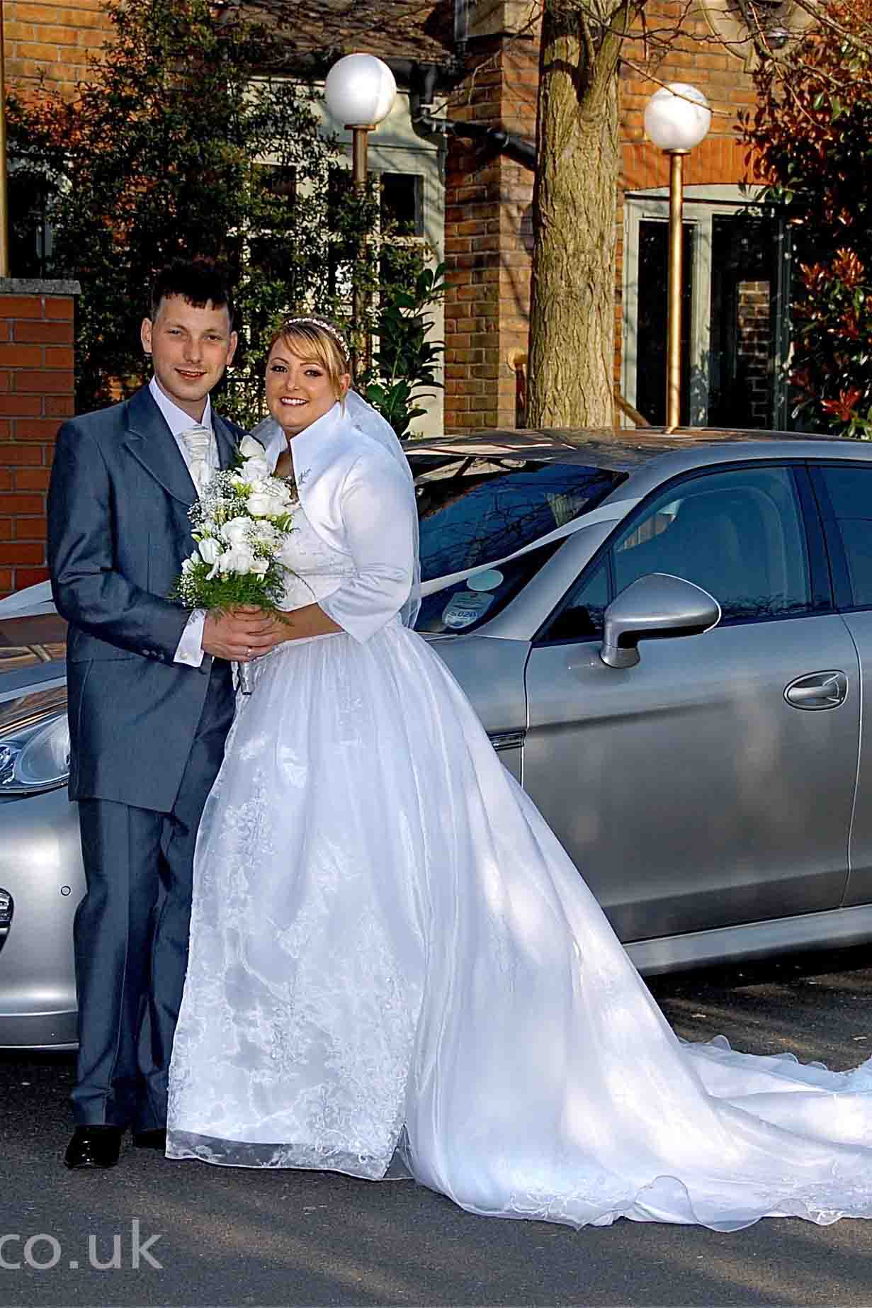 Bride and groom by car, Morden by Epsom Photography..