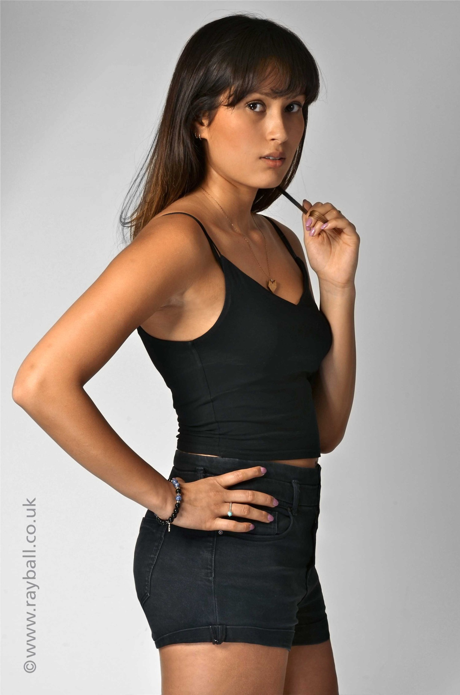 Surbiton model in black vest and shorts in Epsom studio.