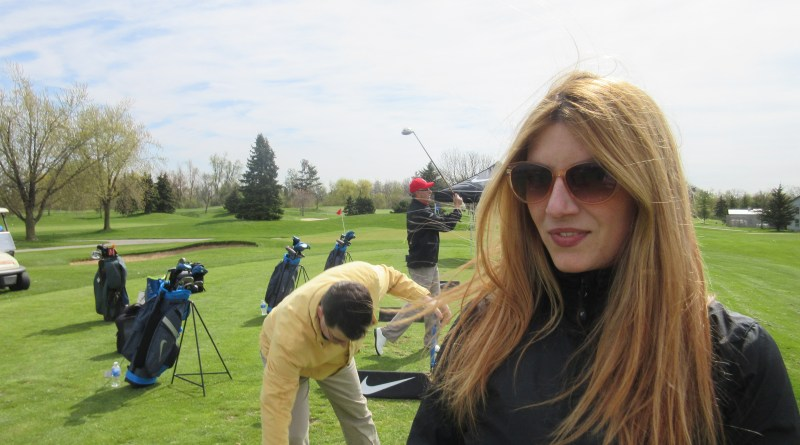 Raymi gets golf lessons at the golf course