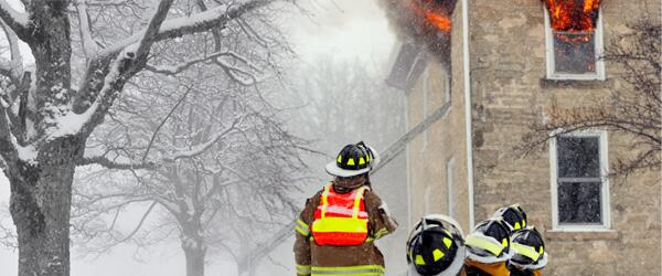 Firemen trying to put out a house that is on fire