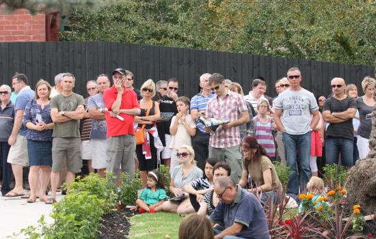 crowd of bidders at property auction
