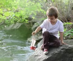 Little boy with boat