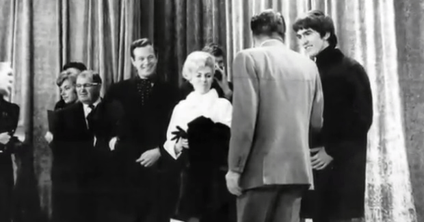 Louise Harrison with Brian Epstein, Ed Sullivan, and ailing George at the Sullivan show rehearsal