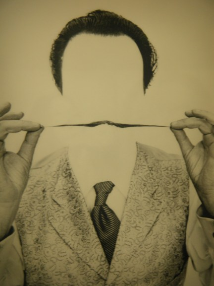 Dali's mustache without dali; notice how the mustache obscures the man.