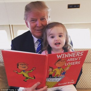 Donald Trump currently the front runner for GOP president reads to his grand-daughter Chloe from that Christmas classic, 'winners aren't lots.' photo by Donald Trump, jr (Chloe's Dad) aboard their car (?) plane (?).