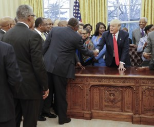 President Trump meets with college presidents at the Resolute desk. Originally the front had portraits of Queen Victoria and President Hayes. Those are gone; the eagle on the front is an addition, as is the bottom stand.