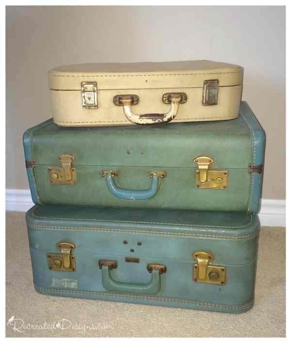 vintage suitcase stack before being made into side table