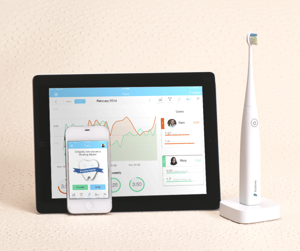 Kolibree brush with phone and tablet Kolibree Toothbrush – throw a high tech dashboard at your cavities, and smile