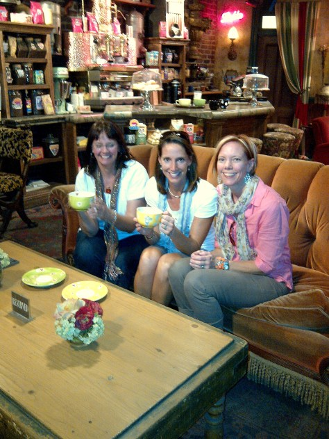 Katsy, Karen, and Julie sitting on Friends couch