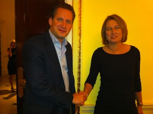 Gavin Stollar, Chair of Liberal Democrat Friends of Israel, warmly shakes hands with Israeli war crimes suspect Tzipi Livni
