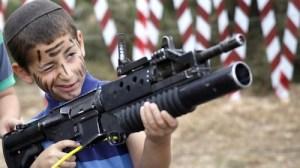 Israeli child holding a gun.jpg