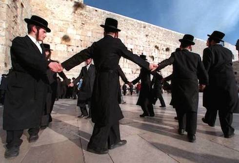 Jewish men dancing at the Western Wall