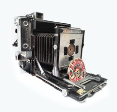 "Photographer Jody Akers converted this old Speedgraphic into a Pinhole camera. Note the Grateful Dead patch ""shutter""."